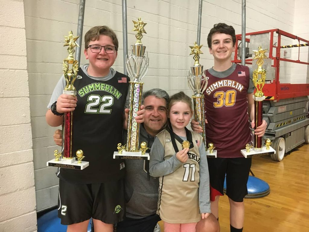 John's family with trophies